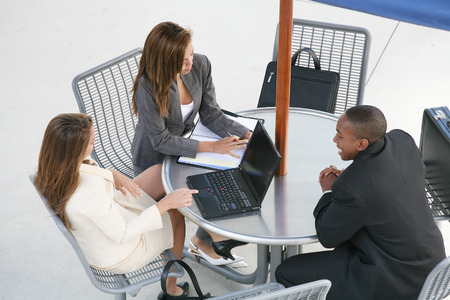 A business team of two women and a man at a table Stock Photo - 1565934
