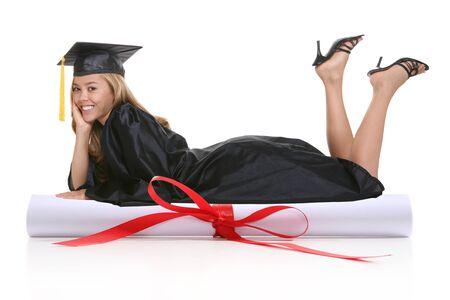 A beautiful woman graduate laying on a  diploma Stock Photo - 1606011
