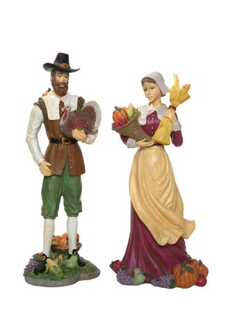 A couple of pilgrims gathering food for Thanksgiving meal photo
