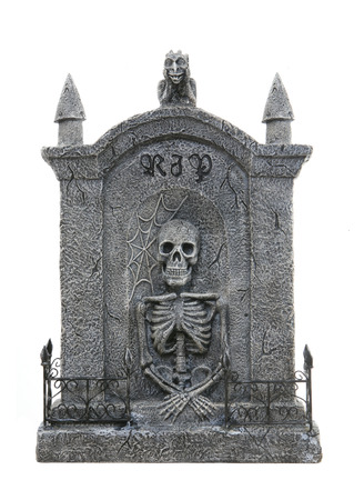 grave site: A scary Halloween tombstone isolated over a white background