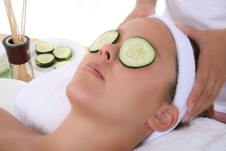 A beautiful young woman getting a facial at the spa Stock Photo - 1629936