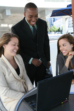 A business tean of two women and a man discussing a project Stock Photo - 1666894