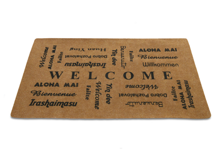 A welcome mat in different languages over a white background
