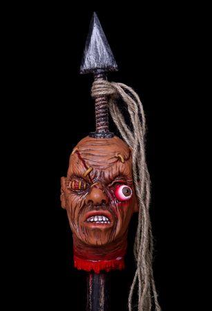 shrunken: A scary Halloween prop of a shrunken head on a spear Stock Photo