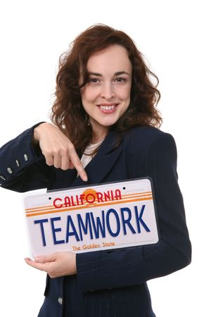 symbiosis: A pretty business woman holding a teamwork license plate Stock Photo