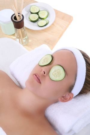 A beautiful young woman getting a facial at the spa photo