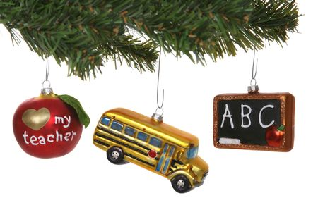 Three school ornaments hanging on a tree photo
