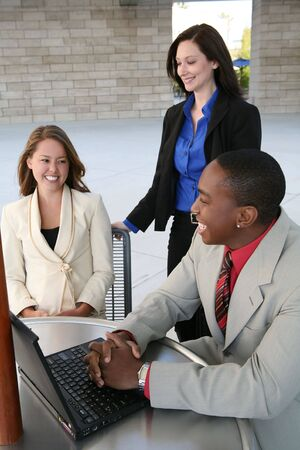 A business tean of two women and a man at a table (Focus on Man) Stock Photo - 1778145