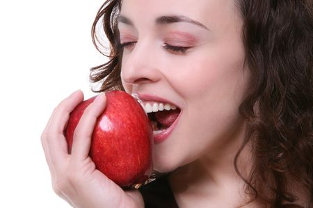 A beautiful young woman eating a red apple isolated over white Stock Photo - 1809719