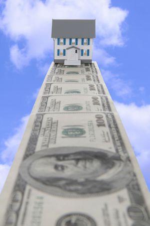 Een geld spoor leidt naar een nieuwe thuis in de wolken Stockfoto - 1833912