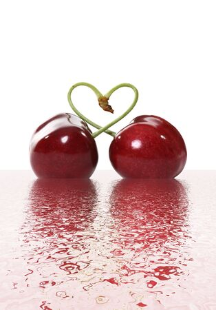 Two cherries tied together in a heart signifying love Stock Photo - 1860199
