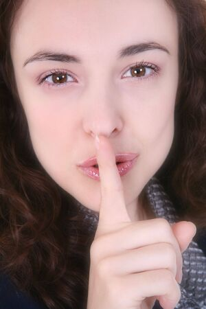 A pretty woman signaling for silence with her finger Stock Photo - 1860184