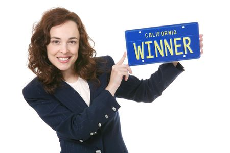 license plate: A pretty business woman holding a winner license plate