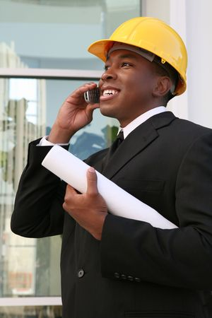 A young man working as an architect on a building site Stock Photo - 1907348
