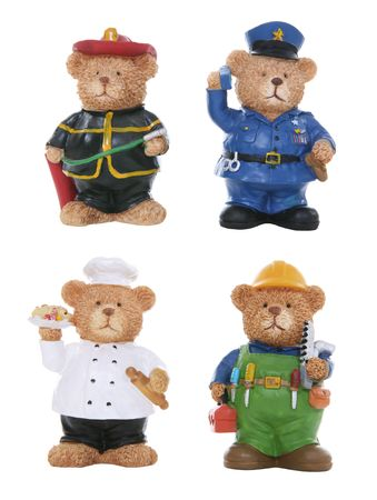A policeman, chef, fireman, contruction worker bear toys isolated over white photo