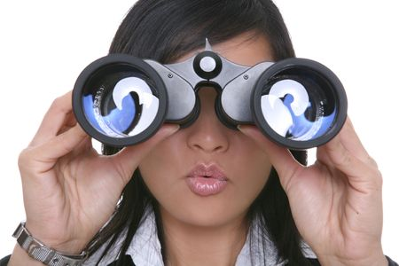 A young pretty asian business woman looking through binoculars Stock Photo