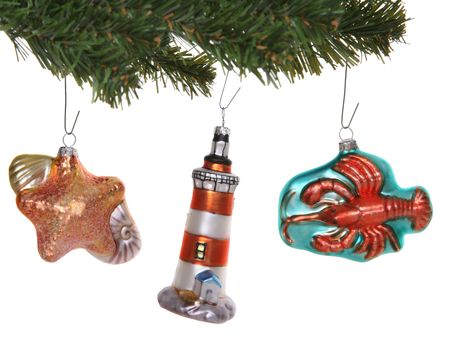 a lighthouse lobster and seashell ornaments hanging on a tree stock photo 1936279
