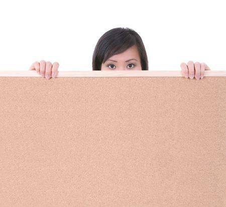 A pretty woman holding a blank bulletin board photo
