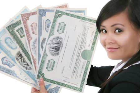 stock certificate: A pretty asian businesswoman holding old stock certificates Stock Photo