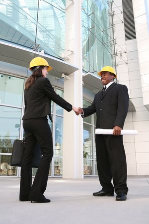An architect shaking hands with his client at the work site Stock Photo - 1963801