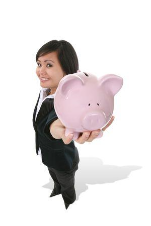 A pretty Asian businesswoman holding a piggy bank photo