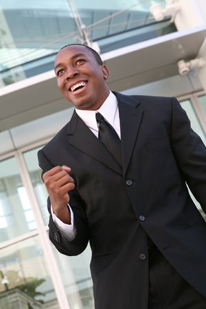 attainment: A young, handsome businessman celebrating upon his success
