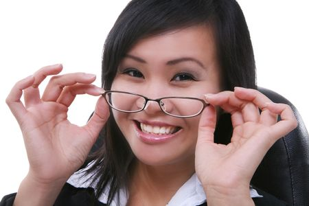 apt: A pretty business woman adjusting her glasses in the office