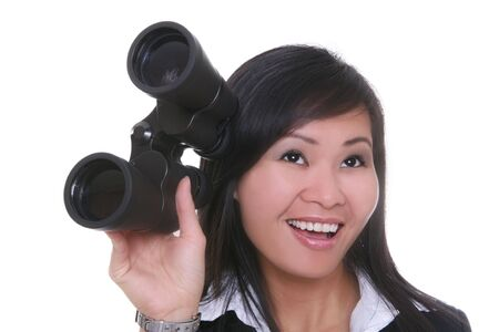 A young pretty asian business holding binoculars Stock Photo - 2032103