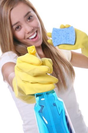 drained: A pretty woman cleaning with spray and sponge