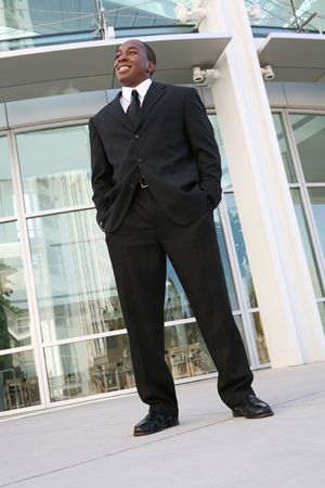 A young, handsome business man standing outside his office building Stock Photo - 2066477
