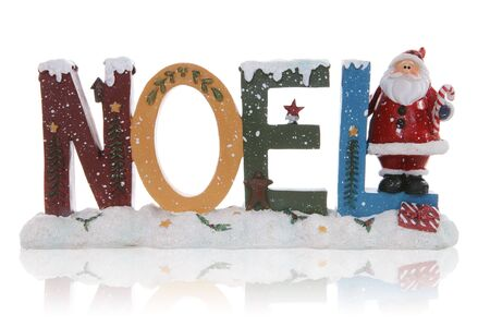 A Christmas themed noel sign with santa claus photo