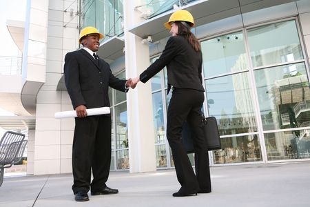 A handsome architect meeting with a client at the worksite photo