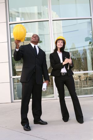A young man and woman working as  architects on a building site Stock Photo - 2118395