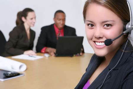 A pretty business woman with her team in the office photo
