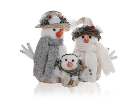 A mother, father and child Christmas holiday snowman