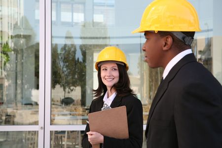 A young man and woman working as  architects on a building site Stock Photo - 2173942