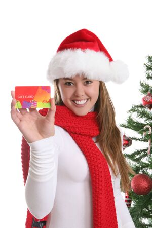 A pretty girl at Christmas holding a gift card Stock Photo - 2190316
