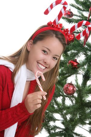 A pretty woman at Christmas with a candy cane photo