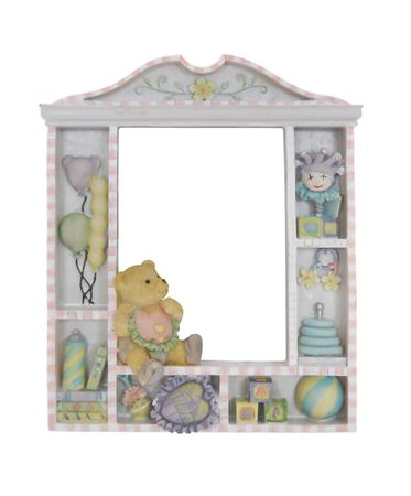 A colorful childs window frame over a white background with toys Stock Photo - 2200528