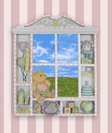 A colorful childs window frame with the grass and sky in background photo
