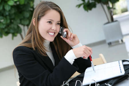 A pretty business woman talking on the phone Stock Photo - 2211028