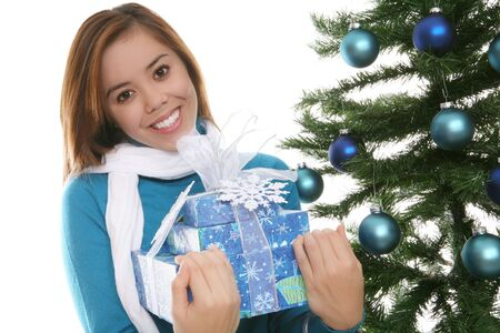 A pretty girl at Christmas holding her presents Stock Photo - 2211027