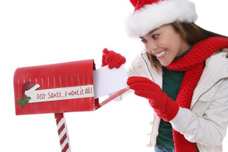 A pretty girl mailing her letter to santa claus at Christmas photo