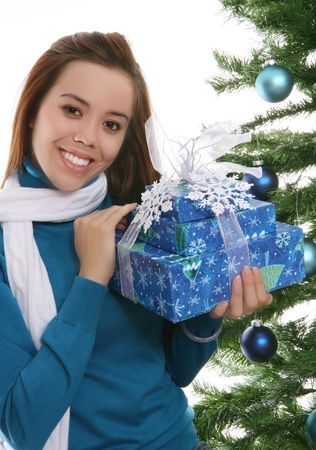 A pretty girl at Christmas holding her presents Stock Photo - 2211033