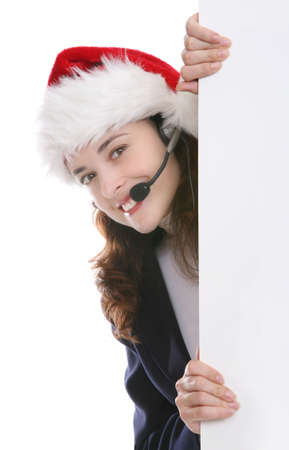 A pretty business woman at Christmas holding a sign photo