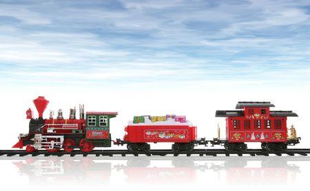 carritos de juguete: Un colorido tren de vacaciones de Navidad en la nieve con un cielo nublado
