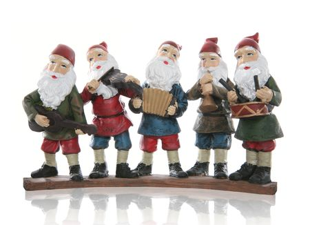 Five elves playing their music instruments at Christmas Stock Photo