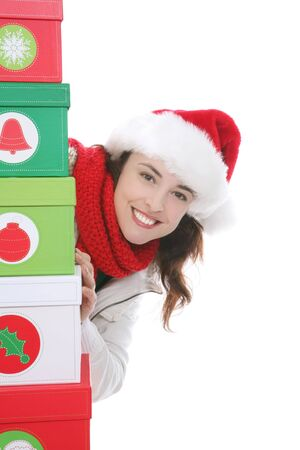 A pretty woman at Christmas hiding behind presents Stock Photo - 2283072