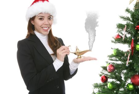 A pretty woman making Christmas wishes with a genie lamp Stock Photo - 2283074