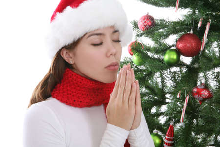 religious clothing: A Pretty Woman praying for a present at Christmas